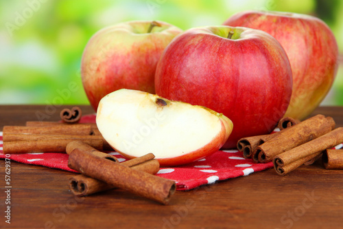 Ripe apples with with cinnamon sticks