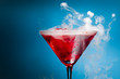 red cocktail with ice vapor