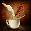 Coffee With Milk Splashing. Cup of Cappuccino or Latte