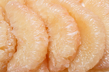Peeled pomelo pieces fruit
