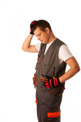 Worried construction worker isolated over white background