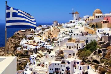 Beautiful view of Santorini with Greek flag