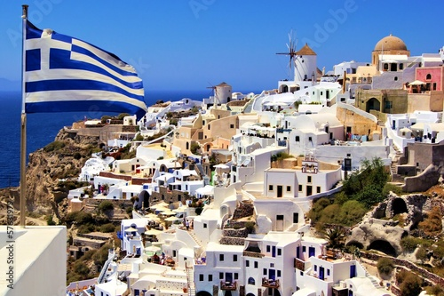 Beautiful view of Santorini with Greek flag