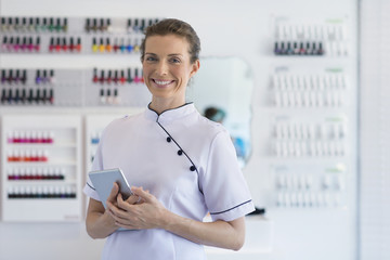 Portrait of smiling nail technician in salon