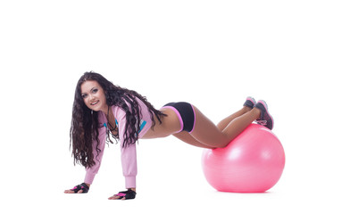 Smiling athletic woman posing with pink sport ball