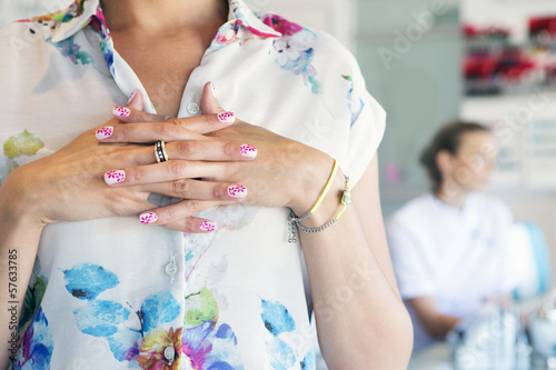 Close up of flower design on woman's manicured fingernails