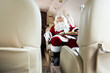 Santa Claus Sleeping In Private Jet