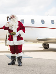Santa Using Cell Phone Against Private Jet
