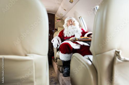 Santa Claus Sleeping In Private Jet - 57633906