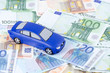 The toy car for euro banknotes as a background