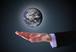 business hand holding globe(Collage images