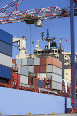 Cargo containers on container ship moored at commercial dock