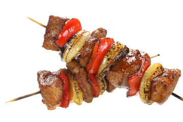 Skewers made with pork, onions and paprika