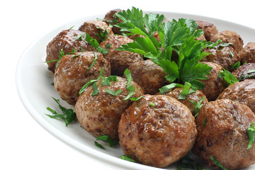 Fried pork meatballs on a plate