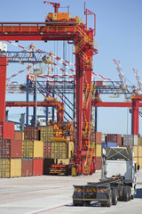 Cranes and cargo containers at commercial dock