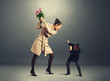 quarrel between man and woman in dark room