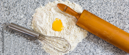 Egg yolk, flour, egg beater and rolling pin.