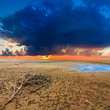 dramatic sunset ower a sand desert