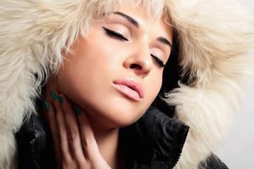 Beautiful fashion woman with fur.white fur hood.winter style