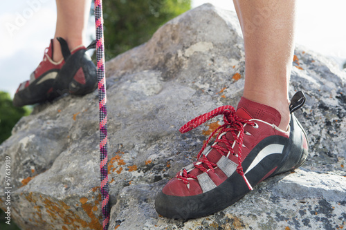 Close up of female rock climber's shoes