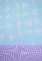 Polka dots pattern for blue wall and purple floor