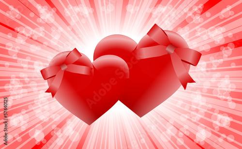 dwa serca ze wstążkami czerwone tło