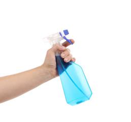 Hand holding blue plastic spray bottle