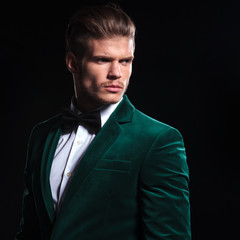 man in a green velvet suit looking away