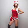 Smiling girl in christmas costume. Short red shorts