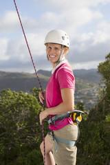 Portrait of confident female rock climber