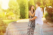 Outdoor portrait of young sensual couple in summer