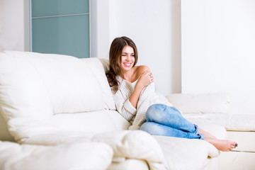 Cute girl sitting on sofa