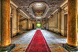 Red carpet in the hallway of an abandoned manor - 57645504