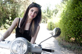 Young female enjoys a motorcycle ride