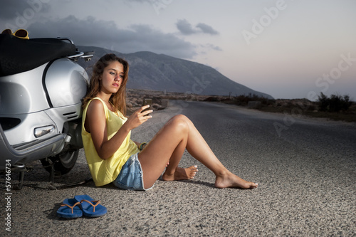 Young female enjoys a motorcycle trip