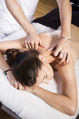 Wellness, Beautiful brunette woman getting a massage