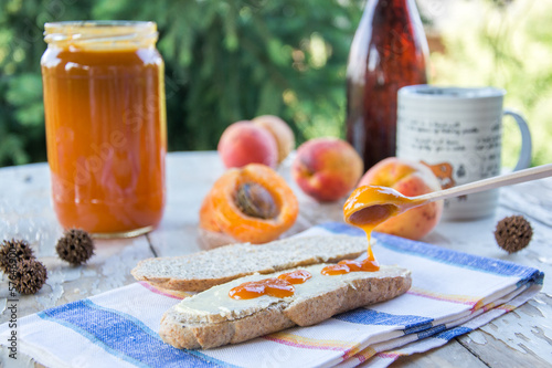 Outdoor breakfast with apricot jam and marmalade