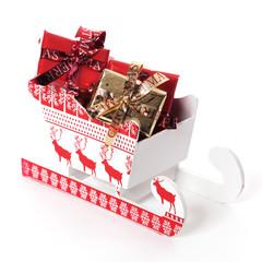 Schlitten mit Weihnachtsgeschenken beladen