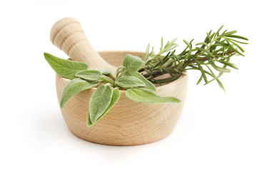 mortar and pestle with sage and rosemary