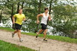 Two young athletes jogging / running in the park