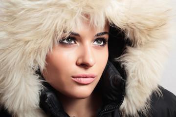 beautiful woman with fur. white fur hood. winter style