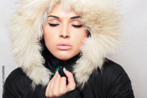 beautiful fashionable woman with fur. white fur hood. winter