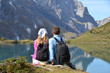 Young couple enjoying Alpine panorama. Switzerland