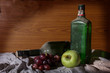 Antique wine bottle with fruits