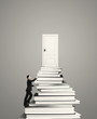 man climbing on stack of books