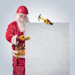 Santa Claus worker in helmet with poster