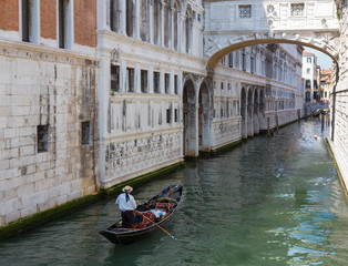 Gondolier in Quiet Canal