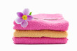 pink and orange towels with anemone flower on it