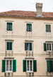 Old Building in Kotor with Green Shutters