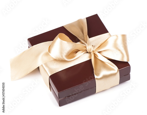 Box with candies and golden tape isolated on the white
